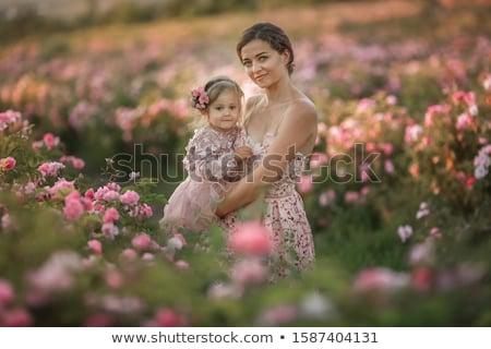 Nő retro ruha lánygyermek 5 éves sétál Stock fotó © ElenaBatkova