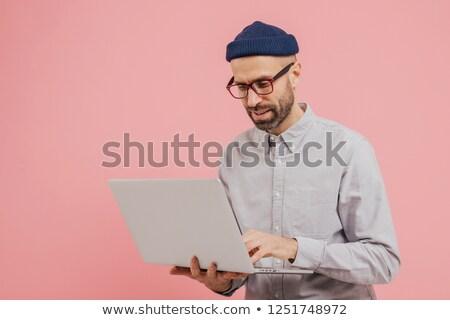 Professionele mannelijke werknemer interessant film horloge Stockfoto © vkstudio