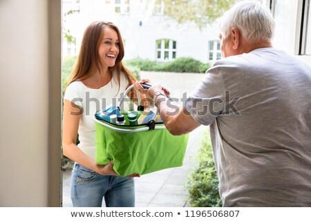 Fiatal gondozó segít idős hordoz élelmiszer Stock fotó © AndreyPopov