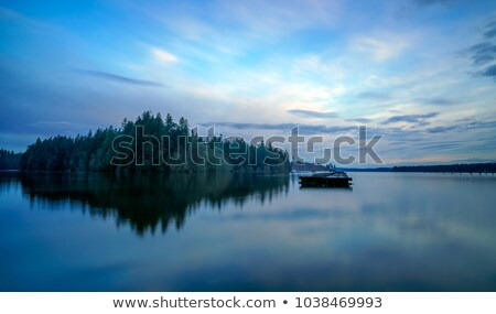 Calm River with Mountain View and Cloud Reflection Stock photo © pixelsnap