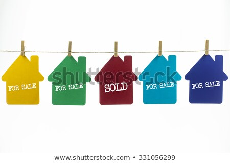 Sold, Colorful words hang on rope stock photo © Ansonstock