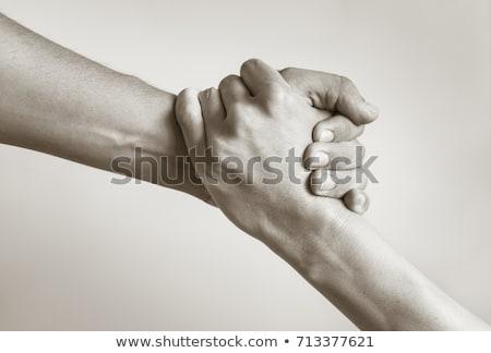 Grasping hands. Stock photo © iofoto