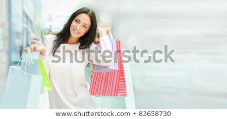 Winkelen vrouw zakken glimlacht binnenkant mall Stockfoto © HASLOO
