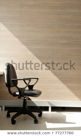 Portrait of a lone office chair facing the right. Stock photo © HASLOO