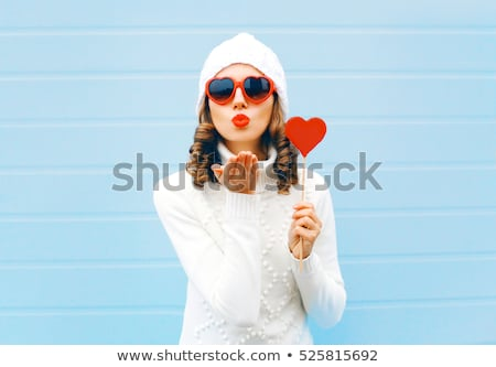 beautiful woman with red lipstick holding red heart Stock photo © Rob_Stark