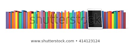 row of colorful books and tablet pc stock photo © andreykr