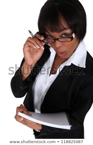 üzletasszony · tart · jegyzettömb · toll · papír · lány - stock fotó © photography33