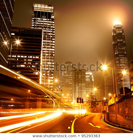 Bus speeding through night street. Hong Kong, China. 