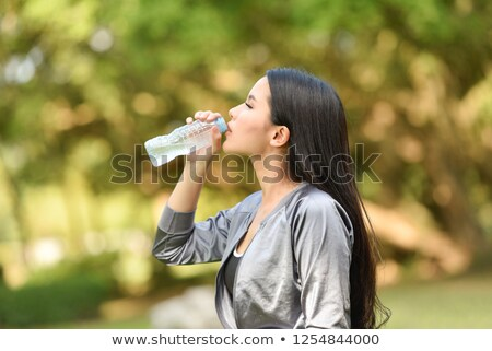 man drinking bottled water in gym foto stock © photography33