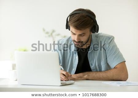 Moço laptop fones de ouvido sessão saco de feijão branco Foto stock © CandyboxPhoto
