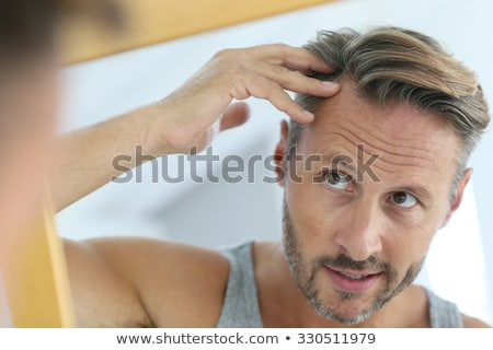 Mature Beauty - Concerned Stock photo © lisafx