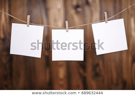 close up of grunge note paper on wooden background  Stock photo © inxti