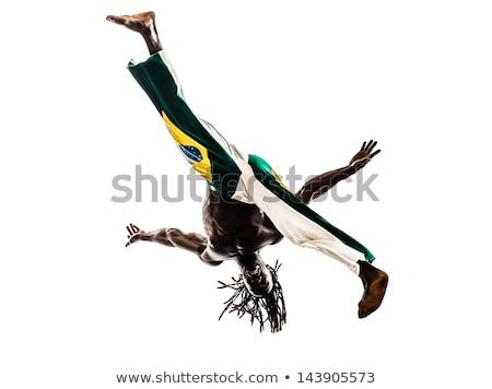 Zwarte acrobaat man dansen studio grijs Stockfoto © get4net