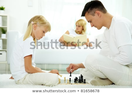 Mother daughter chess match Stock photo © photography33
