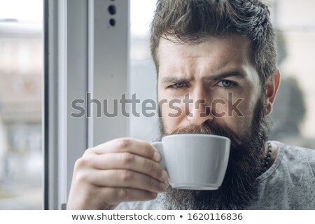 Attractive businessman holding a drinking cup  stock photo © wavebreak_media
