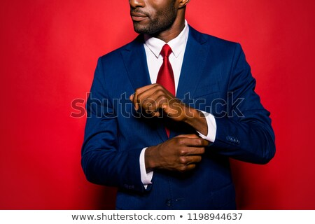 Young businessman corrects a cuff link  Stock photo © wavebreak_media
