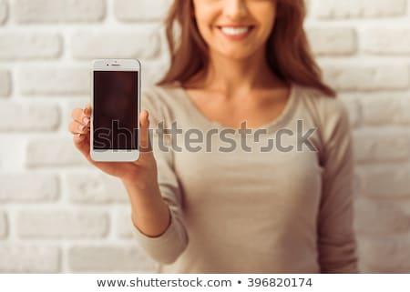 gülümseyen · kadın · beyaz · gülümseme · telefon - stok fotoğraf © wavebreak_media
