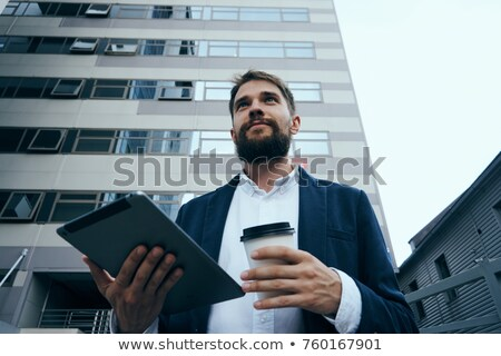 Men With Tablet on street walking stock photo © adamr