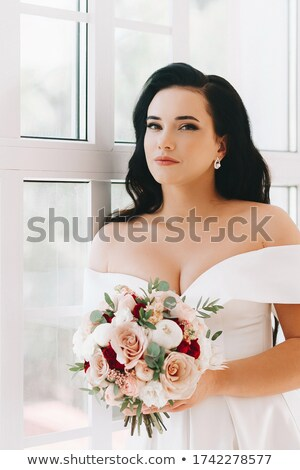 beautiful bride with large flower in hair stock photo © rosipro