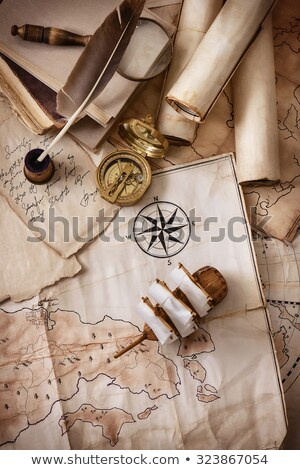 Old Maps in rolls with magnifier and compass stock photo © gavran333