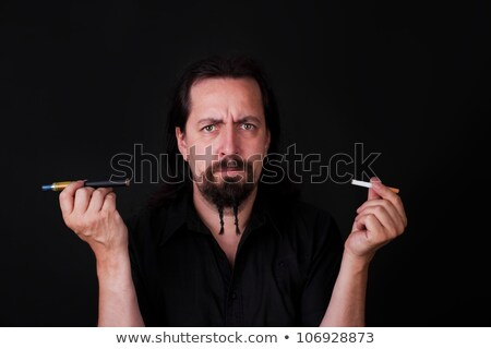 handsome caucasion man holding electronic and ordinary cigarette Stock photo © Pasiphae