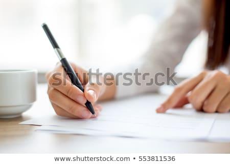 Mulher de negócios caneta papel jovem óculos Foto stock © kyolshin