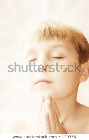 Hands together in prayer with divine aura  Stock photo © dacasdo