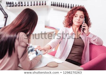 Nő telefon manikűrös fiatal nő recepció ír Stock fotó © wavebreak_media
