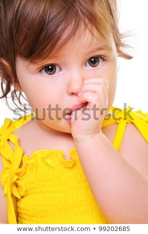 small child holding a finger in his mouth studio photos close  stock photo © dacasdo