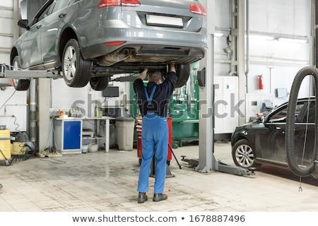 Man is refilling oil in his car Stock photo © Kzenon