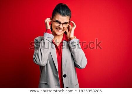 Genç esmer işkadını gözlük kapak kulaklar Stok fotoğraf © sebastiangauert