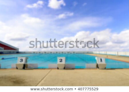 swimming start platform with number one two three and blue sky stock photo © nuiiko
