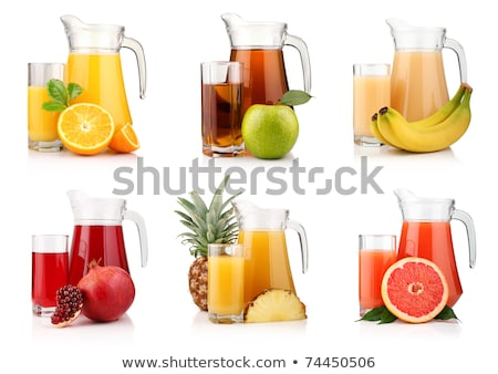 Stock photo: Pomegranate fruit juice in glass pitcher