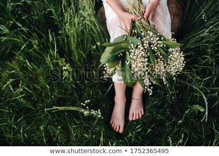 Hermosa sonriendo nina flor blanca pelo playa Foto stock © Nejron