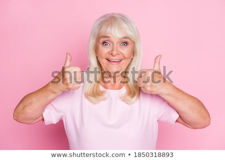 Senior vrouw tonen teken beide Stockfoto © bmonteny