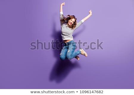 Dziewczyna skoki szary ściany kobiet ulicy Zdjęcia stock © ongap