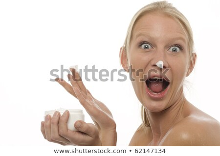 woman with open mouth who plays with the moisturizing cream on the nose stock photo © ambro