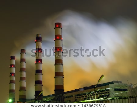 pipe emits smoke into the atmosphere night view stock photo © cherezoff