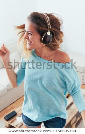 Nina escuchar música casa baile cantando felizmente Foto stock © Giulio_Fornasar