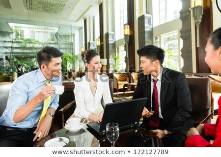 business · team · laptop · werken · hotelkamer · zakenreis · mensen - stockfoto © kzenon