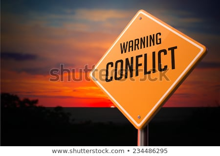 конфликт предупреждение дорожный знак закат небе власти Сток-фото © tashatuvango