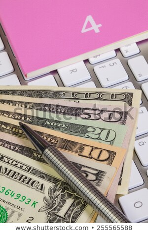 Business desk - Diary for April,US dollars,pen and keyboard Stock photo © CaptureLight