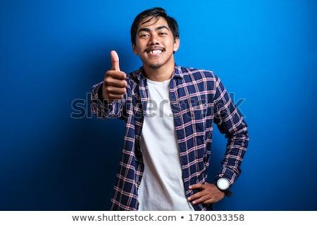Jól kinéző fiatalember valami kezek copy space designer Stock fotó © iko
