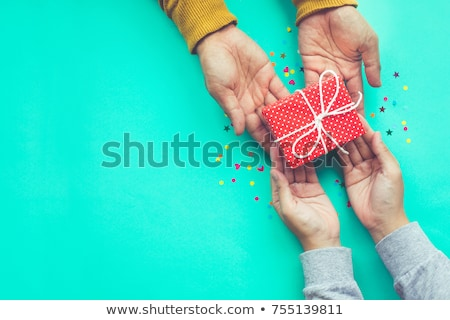 Ajándék közelkép férfi ezüst csomagolás kéz Stock fotó © elly_l