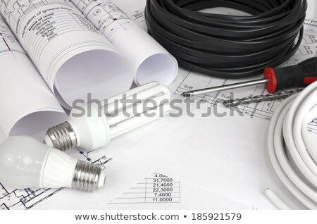 scrolls architectural drawings with electrical cable and bulbs stock photo © cherezoff