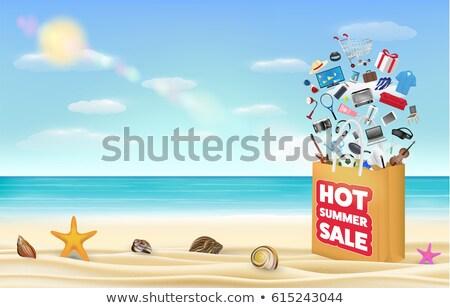 summer discount in orange label over sea background stock photo © marinini