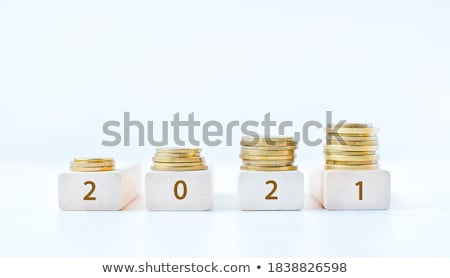 A stack of coins, placed horizontally on a white background Stock photo © AlisLuch