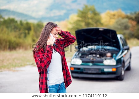 Woman standing near broken car Stock photo © deandrobot