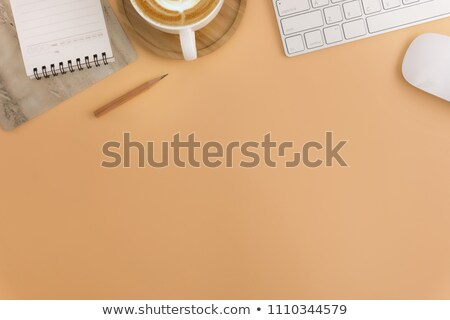 light brown notepad book and pencil stock photo © alexmillos