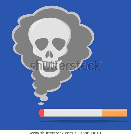 Burning cigarette with skull Stock photo © stokkete